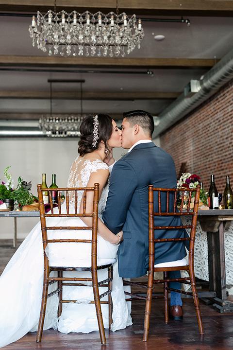 San-juan-capistrano-wedding-shoot-at-franciscan-gardens-bride-and-groom-sitting-kissing