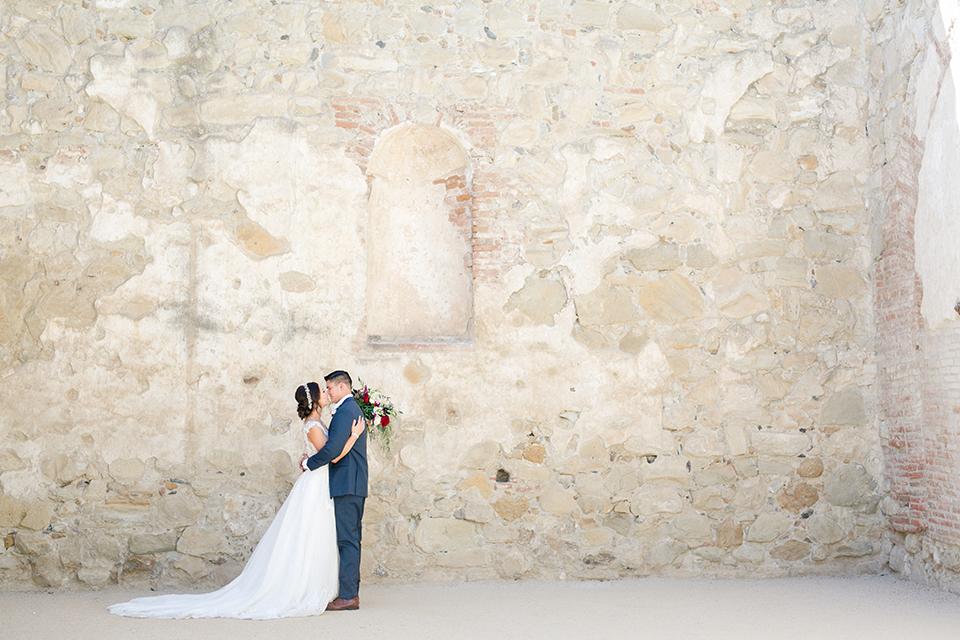 San-juan-capistrano-wedding-shoot-at-franciscan-gardens-bride-and-groom-standing-far-away