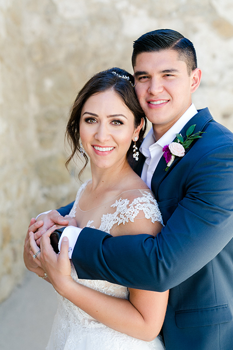 San-juan-capistrano-wedding-shoot-at-franciscan-gardens-bride-and-groom-standing-hugging
