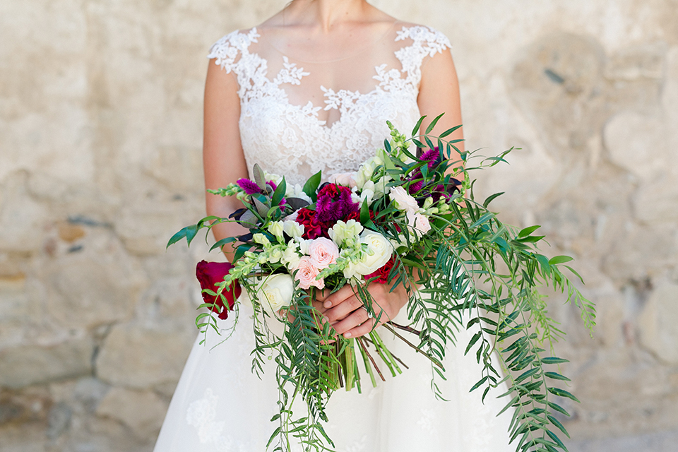 San-juan-capistrano-wedding-shoot-at-franciscan-gardens-bride-holding-bouquet-close-up