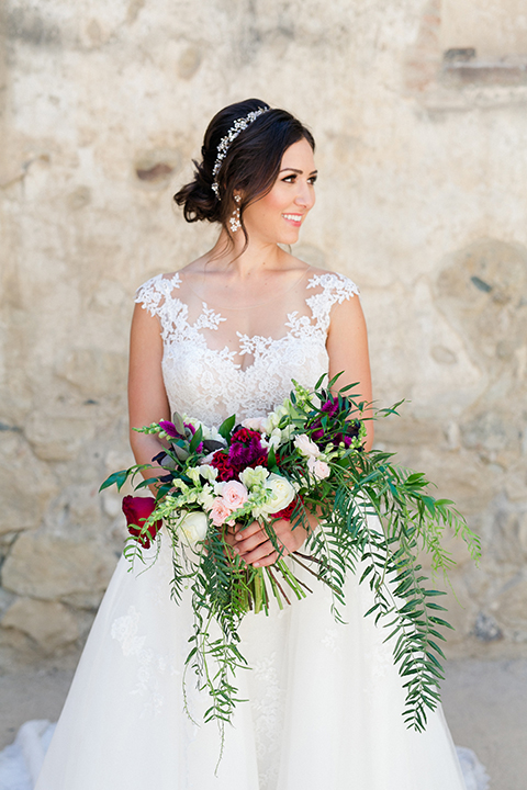 San-juan-capistrano-wedding-shoot-at-franciscan-gardens-bride-holding-bouquet