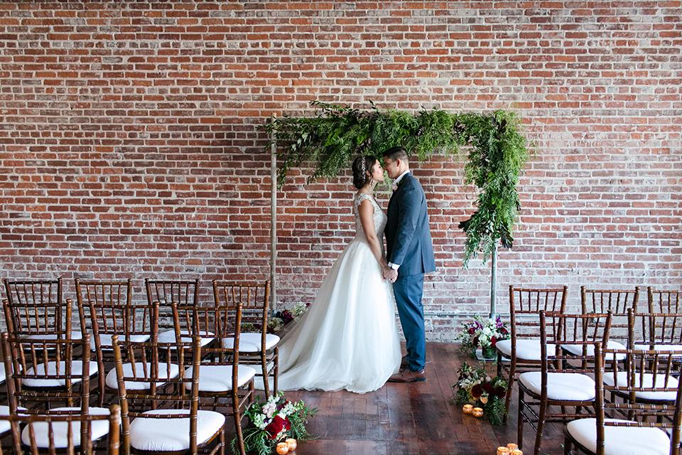 San-juan-capistrano-wedding-shoot-at-franciscan-gardens-ceremony-bride-and-groom-holding-hands