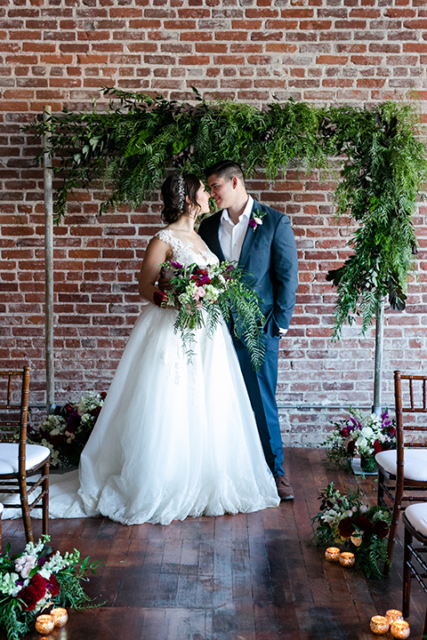 San-juan-capistrano-wedding-shoot-at-franciscan-gardens-ceremony-bride-and-groom-kissing