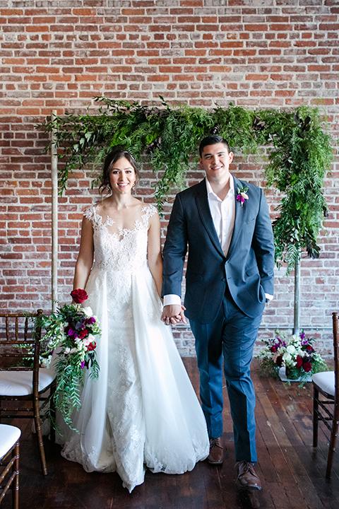 San-juan-capistrano-wedding-shoot-at-franciscan-gardens-ceremony-bride-and-groom-walking