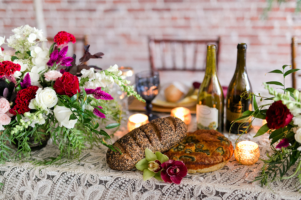 San-juan-capistrano-wedding-shoot-at-franciscan-gardens-table-set-up-with-flowers