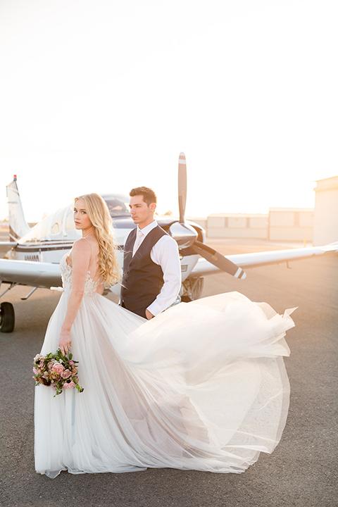 Orange-county-wedding-at-fullerton-hangers-bride-and-groom-holding-hands