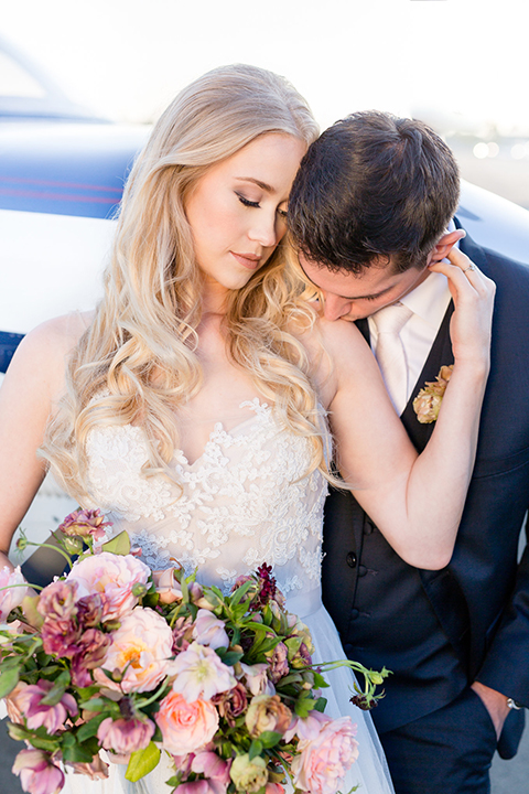 Orange-county-wedding-at-fullerton-hangers-bride-and-groom-hugging-and-kissing-close-up