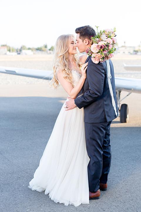 Orange-county-wedding-at-fullerton-hangers-bride-and-groom-hugging-and-kissing