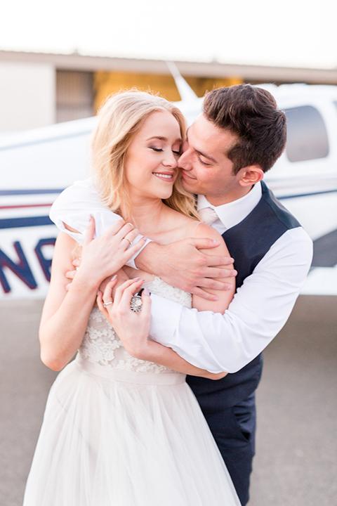 Orange-county-wedding-at-fullerton-hangers-bride-and-groom-hugging-and-smiling