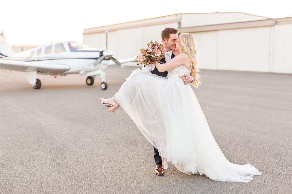 Orange-county-wedding-at-fullerton-hangers-bride-and-groom-kissing-hugging