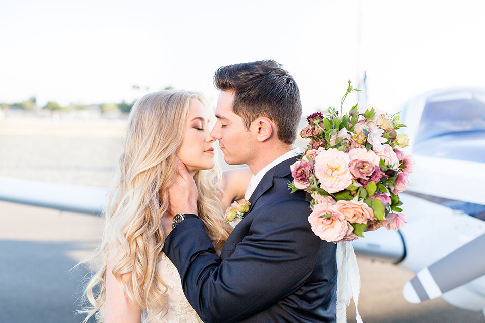Orange-county-wedding-at-fullerton-hangers-bride-and-groom-kissing