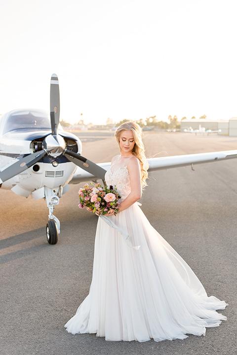 Orange-county-wedding-at-fullerton-hangers-bride-holding-bouquet