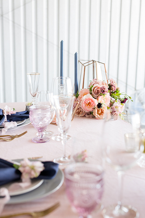 Orange-county-wedding-at-fullerton-hangers-table-set-up-with-flowers