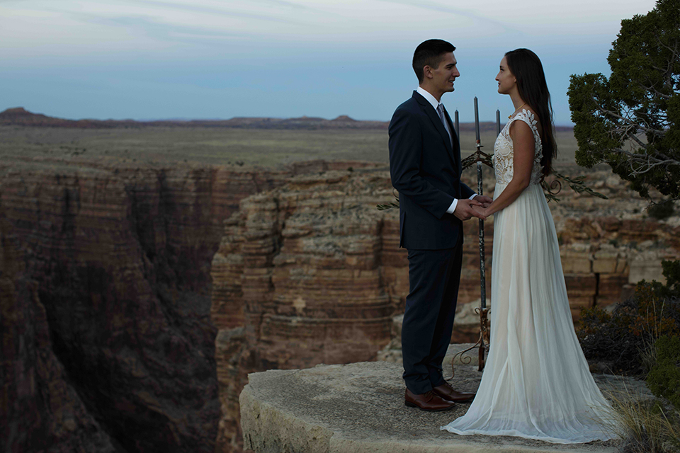 Grand-canyon-wedding-shoot-bride-and-groom-holding-hands