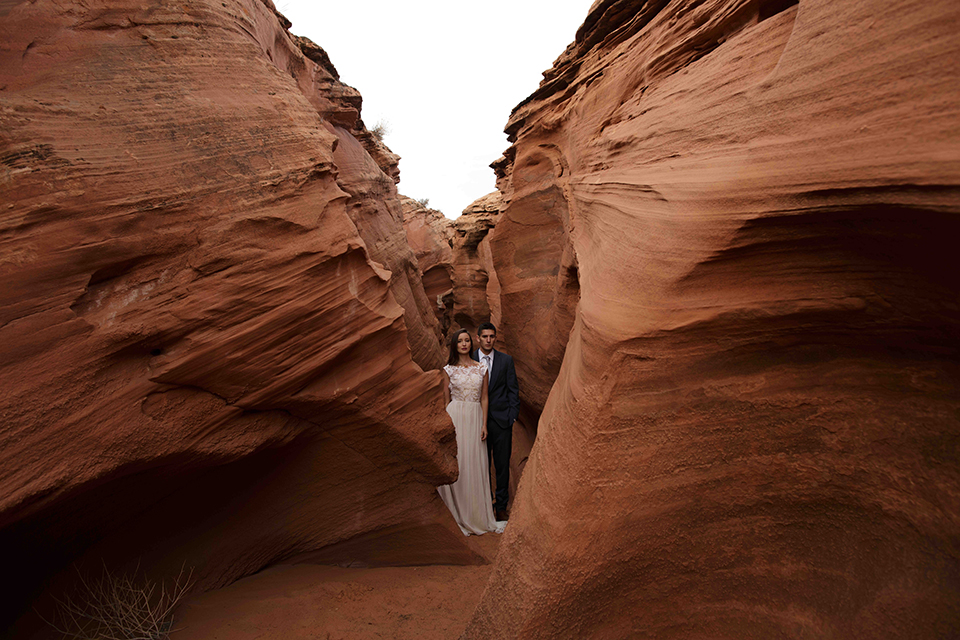 Grand-canyon-wedding-shoot-bride-and-groom-standing-by-rocks