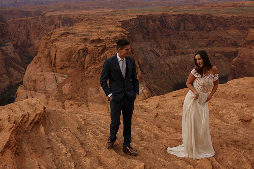 Grand-canyon-wedding-shoot-bride-and-groom-standing-outside-dancing