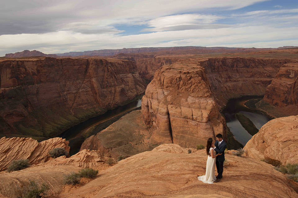 Grand-canyon-wedding-shoot-bride-and-groom-standing-outside-far-away