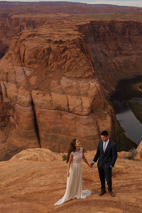 Grand-canyon-wedding-shoot-bride-and-groom-standing-outside-holding-hands