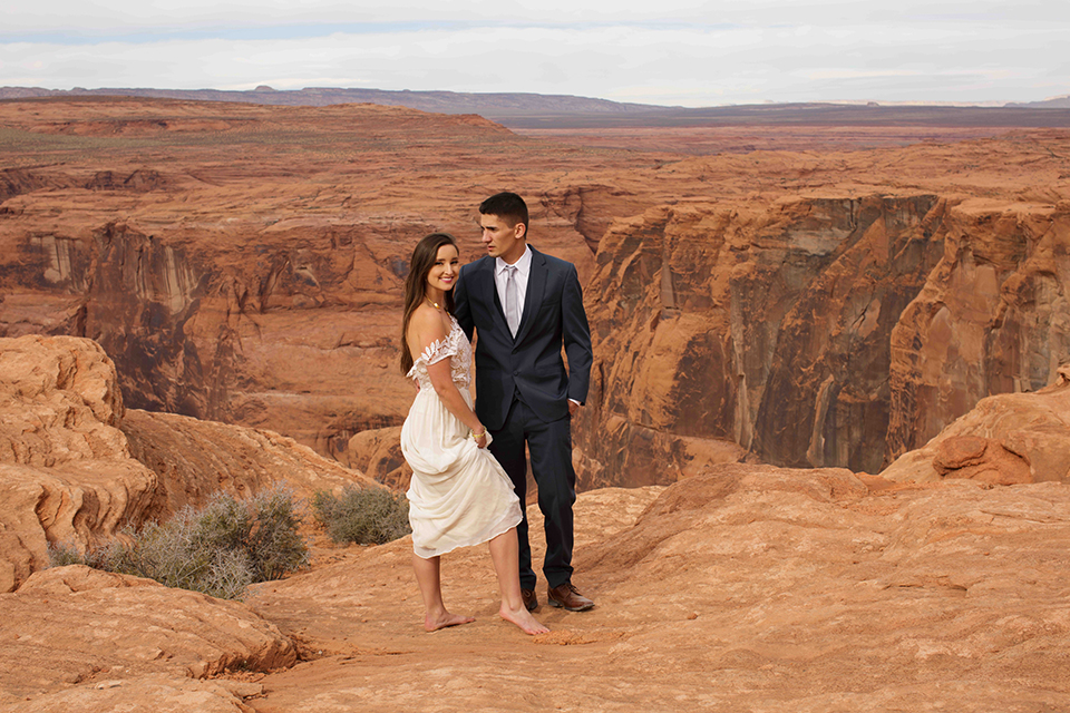 Grand-canyon-wedding-shoot-bride-and-groom-standing-outside-hugging