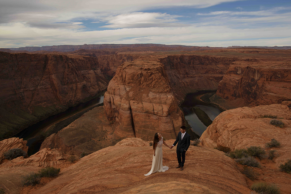 Grand-canyon-wedding-shoot-bride-and-groom-standing-outside-smling