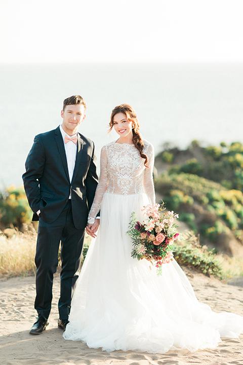 San-diego-outdoor-wedding-shoot-hawaiian-inspiration-bride-and-groom-holding-hands