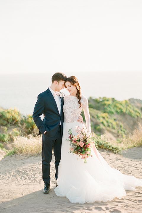 San-diego-outdoor-wedding-shoot-hawaiian-inspiration-bride-and-groom-hugging-holding-hands
