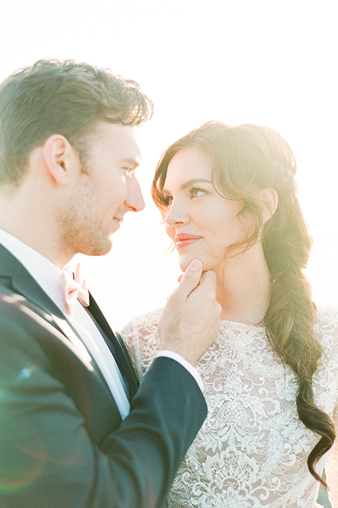 San-diego-outdoor-wedding-shoot-hawaiian-inspiration-bride-and-groom-hugging-smiling