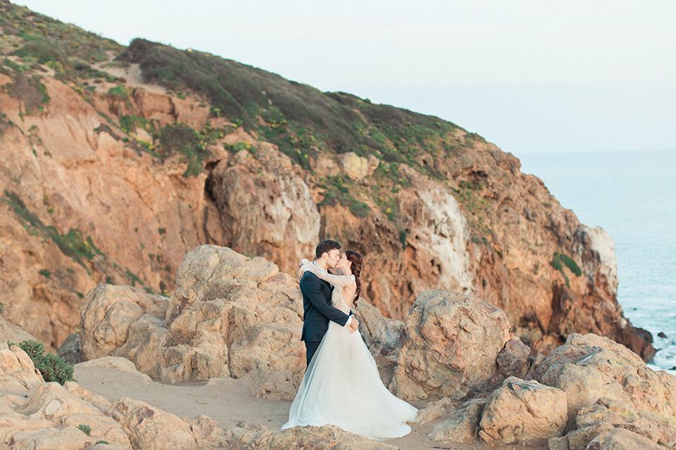 San-diego-outdoor-wedding-shoot-hawaiian-inspiration-bride-and-groom-kissing-and-hugging