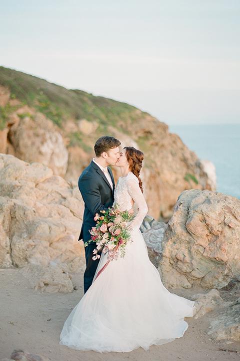 San-diego-outdoor-wedding-shoot-hawaiian-inspiration-bride-and-groom-kissing-hugging