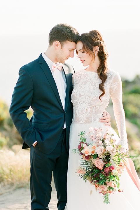 San-diego-outdoor-wedding-shoot-hawaiian-inspiration-bride-and-groom-standing-hugging