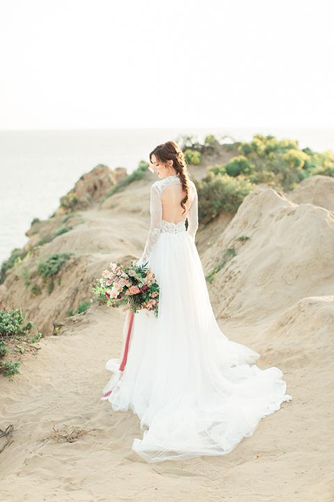 San-diego-outdoor-wedding-shoot-hawaiian-inspiration-bride-holding-bouquet-back-of-dress