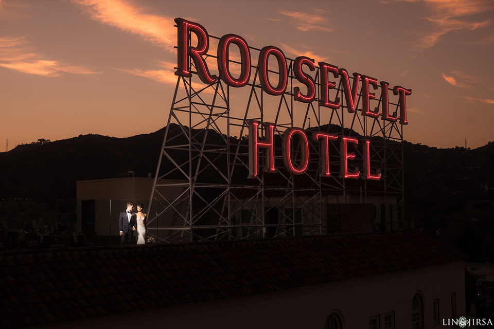 Los-angeles-wedding-shoot-hollywood-roosevelt-bride-and-groom-standing-by-sign