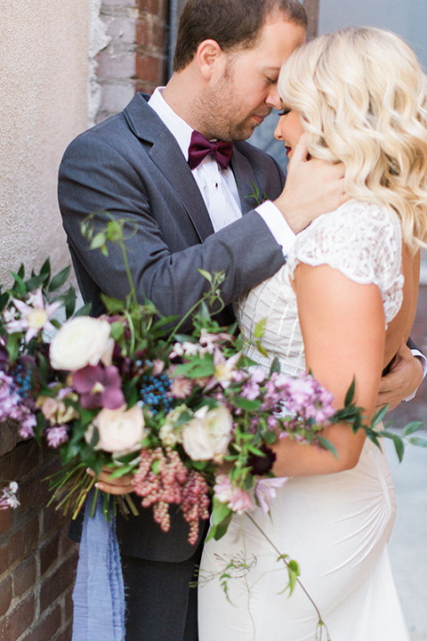 Long-beach-wedding-shoot-at-howl-bride-and-groom-standing-hugging-close-up