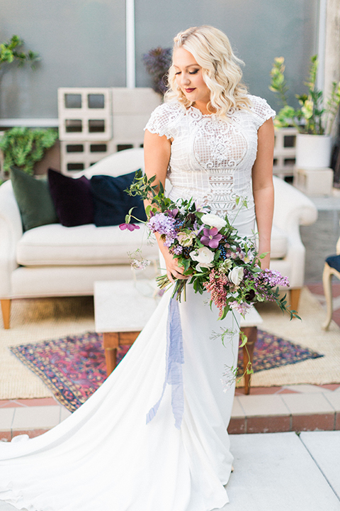 Long-beach-wedding-shoot-at-howl-bride-holding-bouquet-close-up