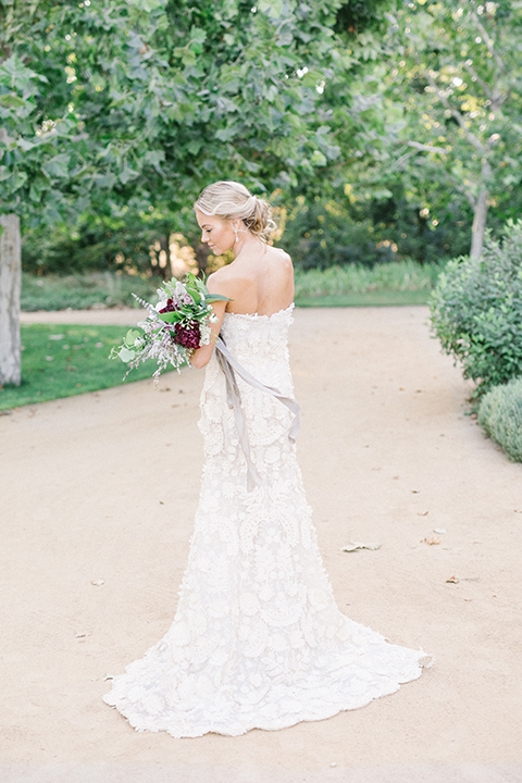 Santa-barbara-outdoor-wedding-at-kestrel-park-bride-holding-bouquet