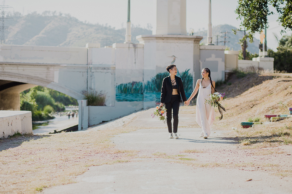 Los angeles same sex wedding shoot brides walking holding hands