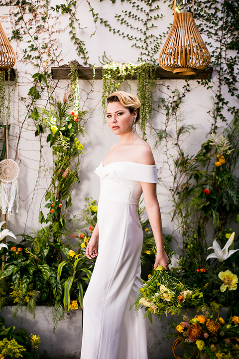 Lesbian-wedding-shoot-at-madera-kitchen-bride-white-jumpsuit