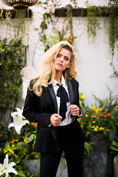 Lesbian-wedding-shoot-at-madera-kitchen-bride-womens-tuxedo-holding-jacket