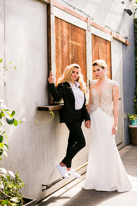 Lesbian-wedding-shoot-at-madera-kitchen-brides-holding-hands