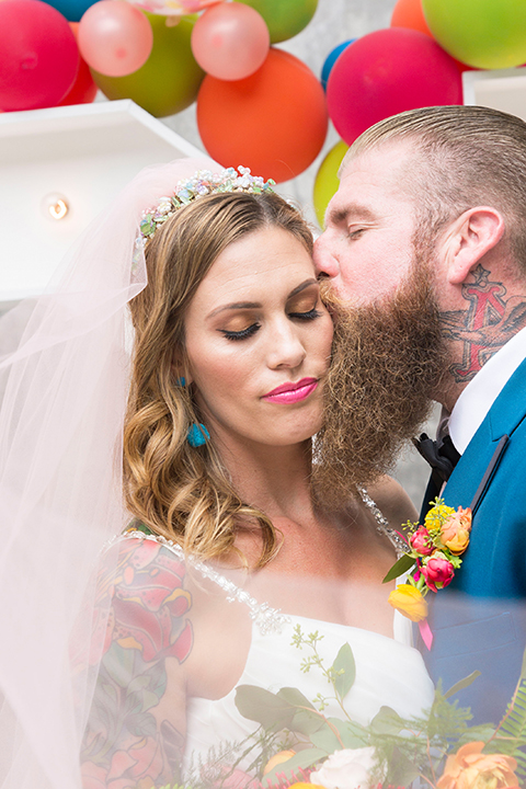 Long-beach-wedding-shoot-at-howl-bride-and-groom-ceremony-kissing-close-up