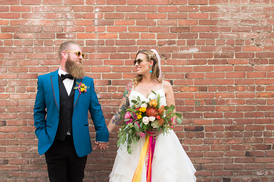 Long-beach-wedding-shoot-at-howl-bride-and-groom-holding-hands-and-smiling