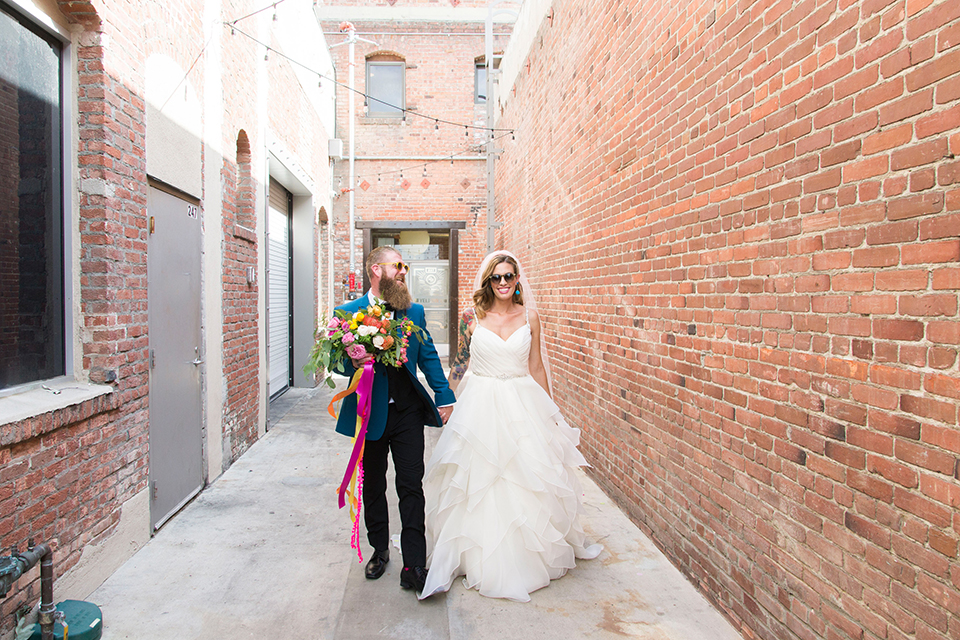 Long-beach-wedding-shoot-at-howl-bride-and-groom-holding-hands-and-walking