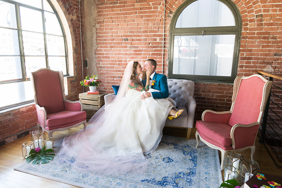 Long-beach-wedding-shoot-at-howl-bride-and-groom-sitting-on-couch