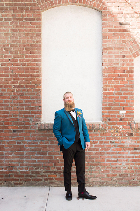 Long-beach-wedding-shoot-at-howl-groom-teal-tuxedo-standing