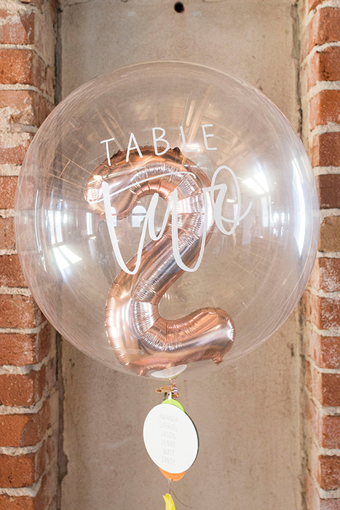 Long-beach-wedding-shoot-at-howl-table-set-up-with-balloon-table-number