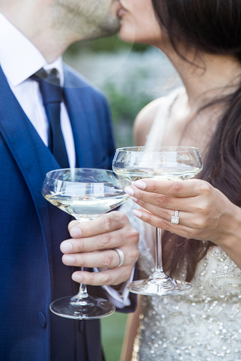 Los-angeles-wedding-shoot-bride-and-groom-kissing-holding-drinks