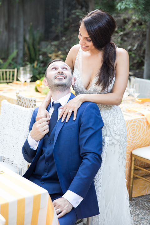Los-angeles-wedding-shoot-bride-and-groom-sitting-and-hugging