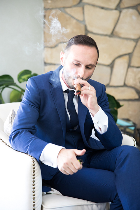 Los-angeles-wedding-shoot-groom-cobalt-suit-holding-cigar