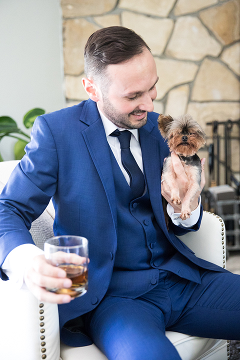 Los-angeles-wedding-shoot-groom-cobalt-suit-holding-dog
