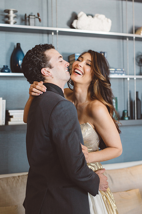 Los-angeles-wedding-shoot-in-santa-monica-bride-and-groom-hugging-and-laughing